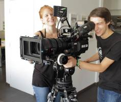 sae-wien-red-camera-with-students